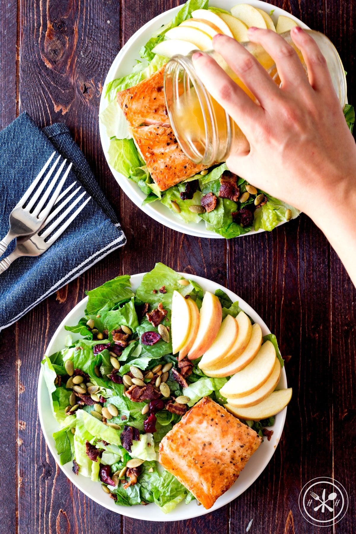 Healthy Fall Salad with Bacon Seared Salmon Pouring Apple Cider Vineagrette