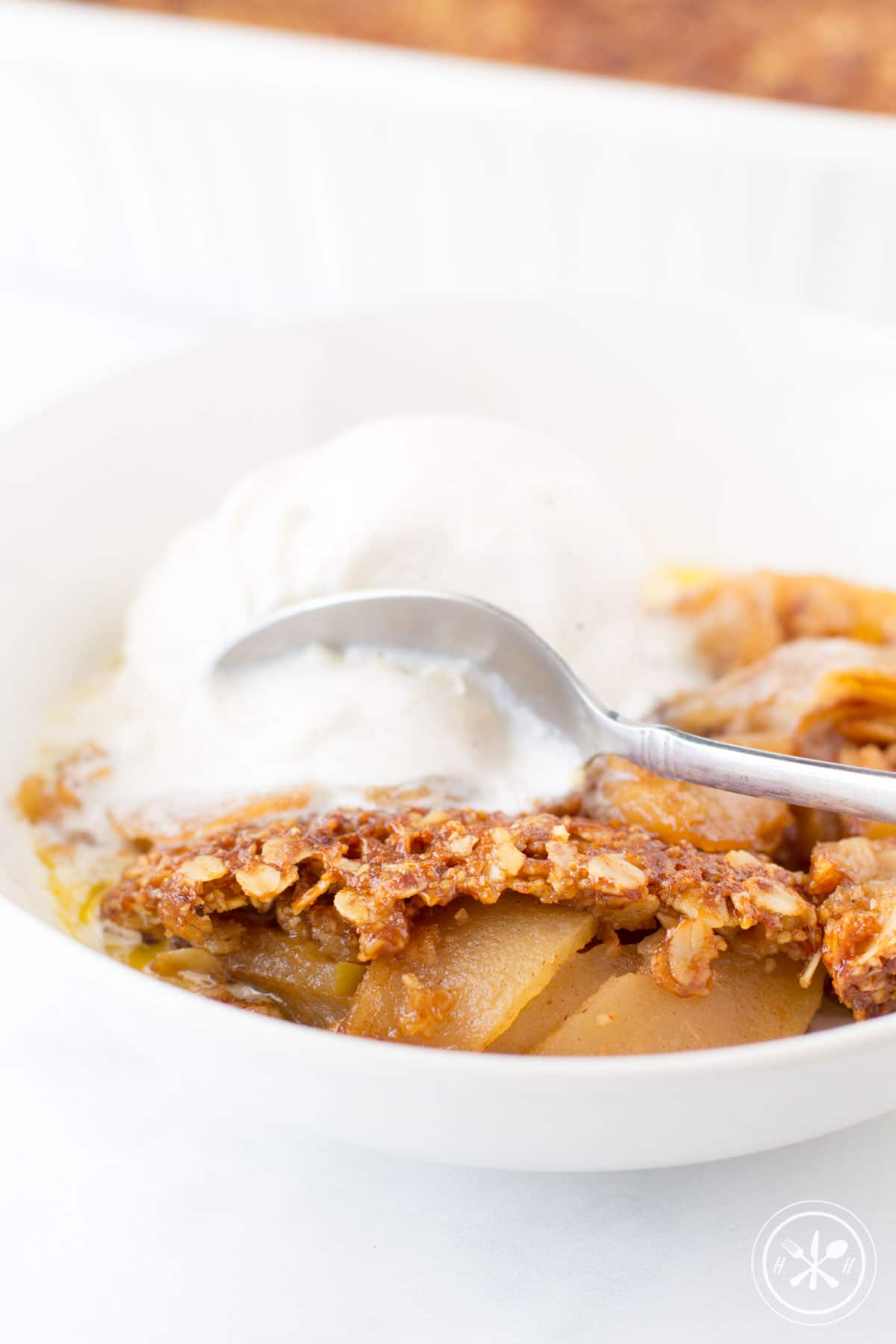 Apple Crisp a la mode with oatmeal topping