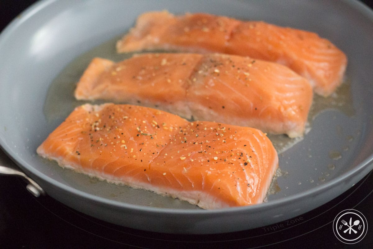 Raw salmon in pan
