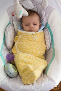 baby in swing and swaddle-1