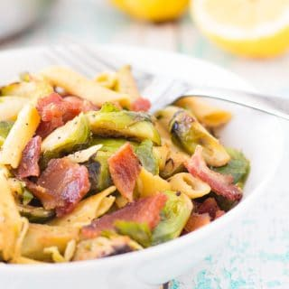 This high protein healthy Brussel sprouts and bacon pasta dinner is almost too good to be true! It uses chickpea pasta to bump up the protein but keeps the flavor with the classic brussel sprout bacon combo, it's going to be your new go to dinner! Top 8 free, low calorie,