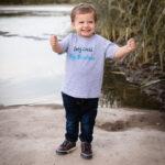 little boy in only child shirt