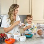 mom and toddler in kitchen eating forager project foods